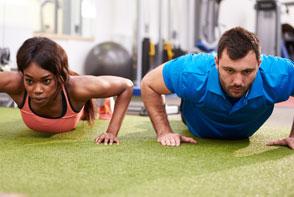 Two people doing pushups
